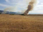 Mott Road fire from High Prairie Road by Margaret Randall - 2