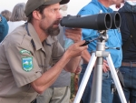 James Day adjusting high powered binoculars