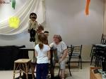 Carol doing a puppet show