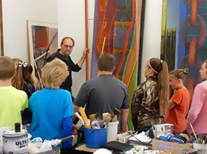 Sonniksen engages students for their opinion about the placement of a color in one of his paintings.