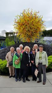 """The Seven"" pose in front of the Chihuly Garden and Glass Exhibit"